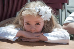 Beautiful girl sitting on the table Royalty Free Stock Photo
