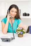 Beautiful girl sitting and talking on phone. Stock Photography
