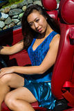 Beautiful girl sitting in to a vintage Ford Mustang GT. Royalty Free Stock Photos