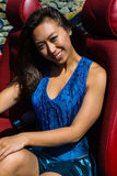 Beautiful girl sitting in a vintage car. Royalty Free Stock Photography