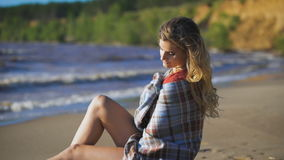 Beautiful girl sitting on wood. Travel and Vacation. Freedom Concept. Sensual blonde beautiful woman stock footage