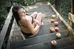 Beautiful girl. Sitting on wooden steps Stock Photography