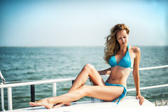 Beautiful girl sitting on the yacht board Royalty Free Stock Images