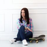 Beautiful girl with skateboard Stock Photography