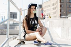 Beautiful girl with skateboard Stock Images