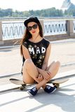 Beautiful girl with skateboard Stock Image