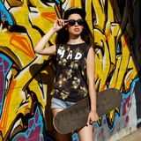 Beautiful girl with skateboard Royalty Free Stock Photography