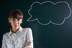 Beautiful girl with sketch thought speech balloon at chalkboard black background Stock Image