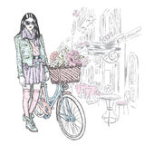 Beautiful girl in a skirt, jacket and glasses with a vintage bicycle on a city street. Vector illustration. Fashion & Style. Beautiful girl in a skirt, jacket Stock Photography