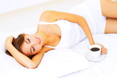 Beautiful girl sleeping. On a white bed Royalty Free Stock Photography