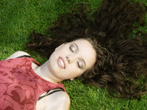 Beautiful girl sleeping. On the grass Stock Photography