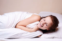 Beautiful girl sleeping in bed. Beautiful young girl sleeping on white bed Royalty Free Stock Photos