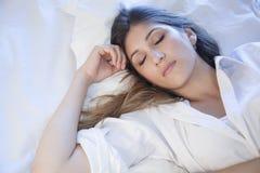 Beautiful girl sleeping in bed. A beautiful girl sleeping in her bed Stock Photos