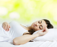 Beautiful girl sleeping. In the bed Stock Image