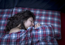 Beautiful girl sleeping. In bed Stock Images