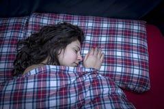 Beautiful girl sleeping. In bed Stock Photos
