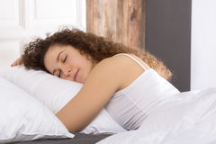 Beautiful girl sleeping in bed alone. Stock Image