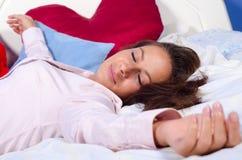 Beautiful girl sleeping in bed. Beautiful girl in pink shirt sleeping in bed Stock Photography