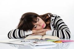 Beautiful girl sleeping on the books. On white table Royalty Free Stock Images