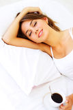 Beautiful girl sleeping with coffee. Beautiful girl sleeping on a white bed Stock Images