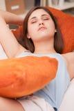Beautiful girl sleeping and dreaming. Beautiful girl sleeping on her sofa in her living room like a sweet angel Royalty Free Stock Image