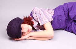 Beautiful girl sleeping at floor Royalty Free Stock Images