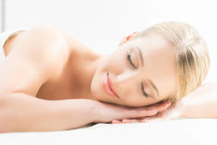 Beautiful girl sleeping and have a spa treatment  on white.Beautiful girl sleeping and have a spa treatment Stock Photo