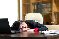 Beautiful girl sleeping at his desk in  office. Beautiful girl sleeping at his desk in the office Royalty Free Stock Images