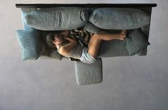 Beautiful girl sleeping lying on the sofa view from above. Relaxing moment concept Royalty Free Stock Images