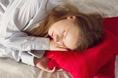Beautiful girl sleeping. Making an impression she's dreaming something nice Royalty Free Stock Photography