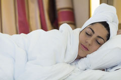 Beautiful girl sleeping in white sheets in  bedroom Stock Photos