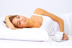 Beautiful Girl Sleeping With A Cup Of Coffee Stock Photography