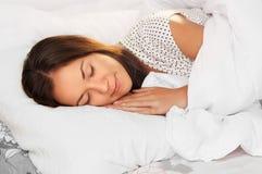 Beautiful girl sleeps in the bedroom Stock Images