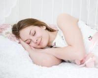 Beautiful girl sleeps Stock Images