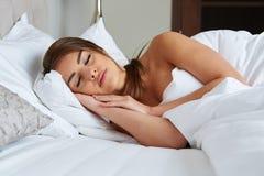 Beautiful girl sleeps in the bedroom Stock Photo