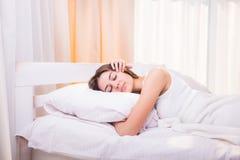 Beautiful girl sleeps in the bedroom Royalty Free Stock Photography