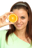 Beautiful girl with sliced orange Royalty Free Stock Images