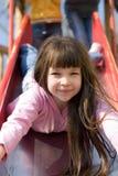 Beautiful Girl on Slide royalty free stock photography