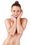 Beautiful girl. Beautiful slim woman covers her bare breasts. Isolated on white background Stock Photos
