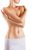 Beautiful girl. Beautiful slim woman covers her bare breasts. Isolated on white background Royalty Free Stock Photography