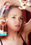 Beautiful girl smartens up stock photography