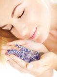 Beautiful girl smell lavender flowers Stock Image