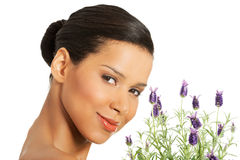 Beautiful girl smell lavender flowers. Beautiful girl smell purple lavender flowers Stock Images
