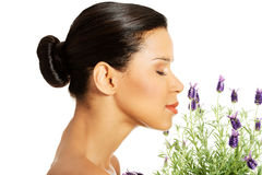 Beautiful girl smell lavender flowers. Beautiful girl smell purple lavender flowers Royalty Free Stock Photos