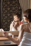 Beautiful girl smelling body lotion Royalty Free Stock Photo