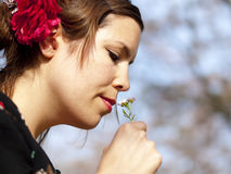 Beautiful girl smelling a cuckoo flower in the spring Stock Photos