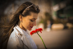 Beautiful girl smelling a flower Stock Photo