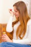 Beautiful girl smelling perfume Stock Photo