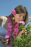 Beautiful girl smelling a rose Stock Photography