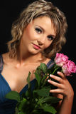 Beautiful girl smelling roses Royalty Free Stock Photos